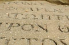 Lettres sur la pierre Image stock