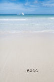 2014 lettres sur le sable, l'océan, la plage et le paysage marin Photographie stock libre de droits