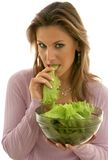 Lettuce. Pretty woman eating lettuce Stock Photo