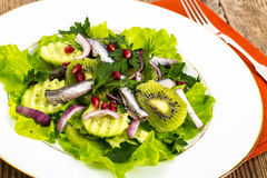 Lettuce with anchovies and pomegranate seeds Stock Photo