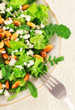 Lettuce, arugula, almond and cheese salad Stock Image