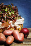 Lettuce in a  basket and vegetable background Stock Image