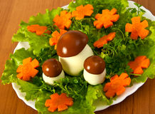 Lettuce and  carrot cutting with mushroom. Carving from lettuce and carrot cutting. Flowers glade Stock Photo