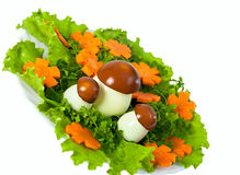 Lettuce and  carrot cutting with mushroom. Carving from lettuce and  carrot cutting. Flowers glade Royalty Free Stock Photo