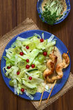 Lettuce, Gooseberry and Red Currant Salad with Chicken Stock Photos