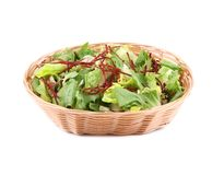 Lettuce leaves and beet in basket. Royalty Free Stock Photos