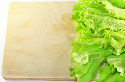 Lettuce lying on wooden cutting board Royalty Free Stock Photography