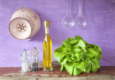 Lettuce, olive oil,salt ,pepper, kitchen utensils, Stock Images