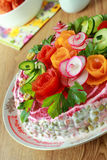 Lettuce of Olivier is decorated by flowers Stock Images