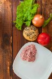 Lettuce, onions, tomato and forcemeat do not table,chopped meat royalty free stock photo