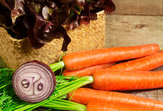 Lettuce, red onion and carrots Stock Photos