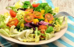 Lettuce salad with fork Stock Photo