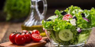 Lettuce salad with tomatoes onion cheese and olives royalty free stock images