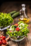 Lettuce salad with tomatoes onion cheese and olives stock photography