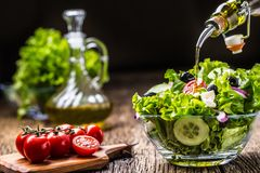 Lettuce salad with tomatoes onion cheese and olives royalty free stock photography