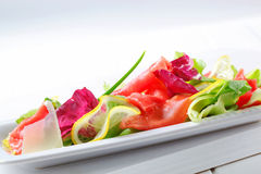 Lettuce with thin slices of lemon and raw beef Stock Photo