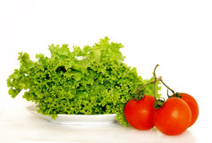 Lettuce and tomatoes. For a salad Royalty Free Stock Photo