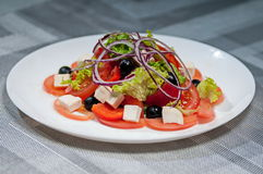 Lettuce with tomatoes  cheese  bow and olives Stock Image