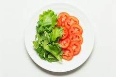 Lettuce and tomatoes over white plate Royalty Free Stock Images