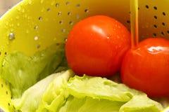 Lettuce tomatoes washing colander Stock Photos