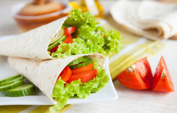 Lettuce and tomatoes wrapped in pita bread Royalty Free Stock Images