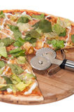 Letuce pizza on the wooden board with pizza cutter Stock Images
