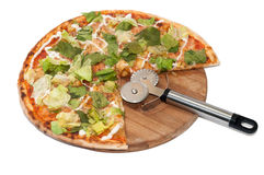 Letuce pizza on the wooden board with pizza cutter Stock Photos