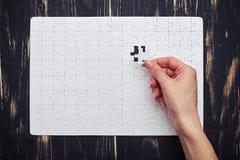 Letztes Puzzlespiel-Stück Stockbilder