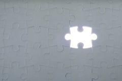 Letztes Stück des Puzzlespiels Stockfotos