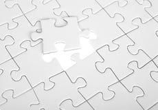 Letztes Stück des weißen Puzzlespiels Lizenzfreie Stockfotos