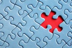 Letztes Stück des Puzzlespiels Stockbild
