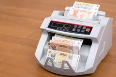 Leu moldove dans une machine de compte photographie stock libre de droits
