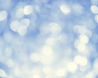 Leuchten auf blauem Hintergrund Stockbild