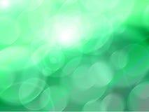 Leuchten auf grünem Hintergrund Stockfoto