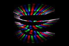 Leuchtende Farben des Regenbogens schleppen in der Form der Spirale Lizenzfreie Stockfotos
