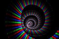 Leuchtende Farben des Regenbogens schleppen in der Form der Spirale Stockbilder