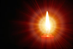 Leuchtende Kerze Stockfotografie
