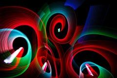 Leuchtende Muster in der Form von Spiralen Stockbilder