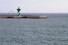 Leuchtfeuer auf Pier Lizenzfreies Stockfoto