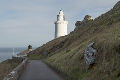 Leuchtturm am Anfangspunkt in Devon Stockbilder