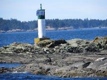 Leuchtturm auf dem Meer stockfoto