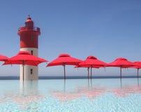 Leuchtturm auf dem Strand Stockfotos