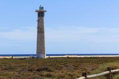 Leuchtturm auf einem Strand in Morro Jable, Kanarische Inseln Fuerteventuras Stockbild