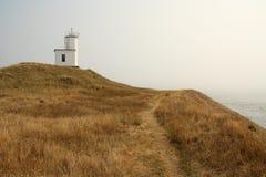 Leuchtturm auf Hügel Stockbilder