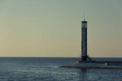 Leuchtturm auf Sonnenuntergang Stockfotos