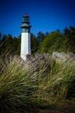Leuchtturm auf Strand stockbilder