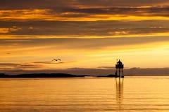 Leuchtturm bei Sonnenuntergang Lizenzfreies Stockbild