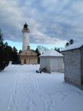 Leuchtturm im Winter Stockfotos