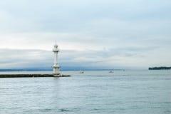 Leuchtturm am Leman See (Gummilack Leman), Genf Lizenzfreie Stockfotos