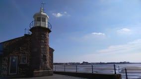 Leuchtturm in Meer Stockfoto